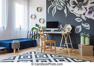 Modern designed bedroom with floral decoration on a black...