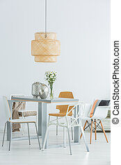 Functional communal table and chairs - White room with...