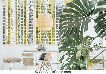 Dining room with decorative lamp