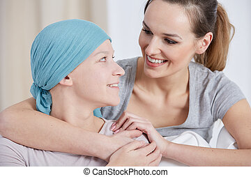 Hopeful cancer woman with friend - Hopeful cancer woman...