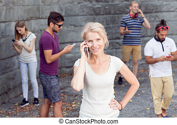 Woman in the crowd - Young woman talking the phone in the...