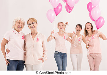 Women with balloons - Happy group of women with pink...