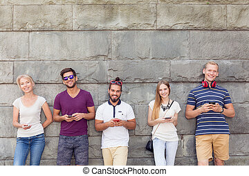 Friends and phones - Group of friends with mobile phones...