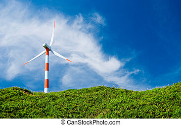 wind turbine in green hill - clean energy concept. wind...