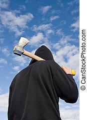 man with axe - man in balaclava with an axe on sky...