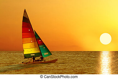 Sailboat on a sunset - Two person sailing in a sailboat on a...