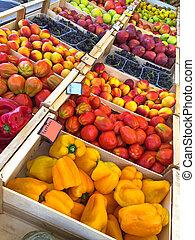 Fresh home grown fruit, vegetables - bell pepper, tomato, grape, apple at farmer market