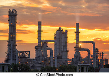 chemical plant and oil refinery industry with sunrise. Pipe...
