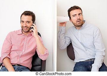 Man spying and listening another man who is having a phone...