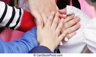 Stacked hands of children