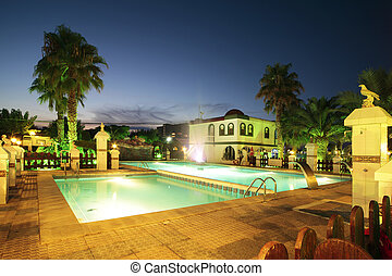 Swimming Pool At Night - Luxury swimming pool and villa at...