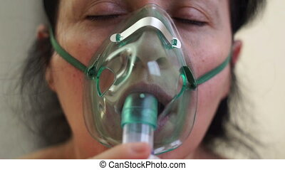 Woman Medical Nebulizer Breathing Mask Front Closeup - Close...