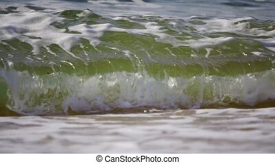 Sparkling wavy water is shining on a sunny day, abstract...