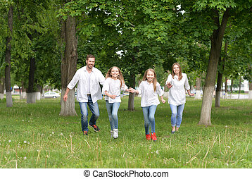 happy family outdoors - Portrait of a happy family outdoors...