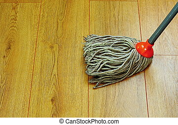 washing wood floor with wet mop - washing the wooden floor...