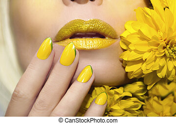Yellow makeup and manicure .