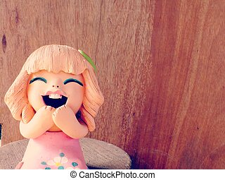 clay dolls children girl smiling and laughing on wooden...