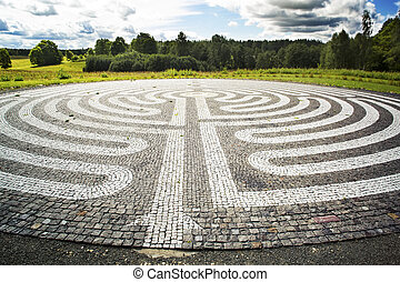 Gothic labyrinth from black and white cobble-stones in the...