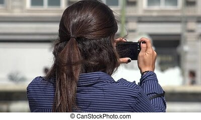 Woman Taking Photos With Camera