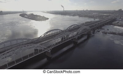 expressway bridge over the river, shooting from the air,...