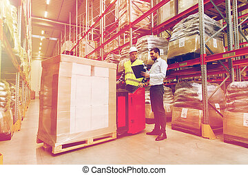 worker on forklift and businessman at warehouse