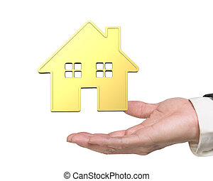 Man's hand showing golden house