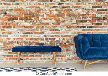Blue upholstered bench - Red brick wall, blue upholstered...