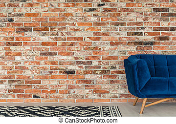 Blue sofa and pattern rug - Red brick wall, blue sofa and...