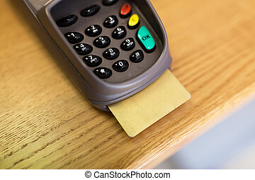 close up of bank card reader or atm terminal - finance,...