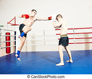 Muay thai fighters at boxing ring - Thai kickboxing. Two...