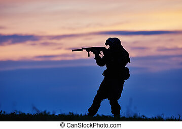 Military soldier silhouette with machine gun - military....