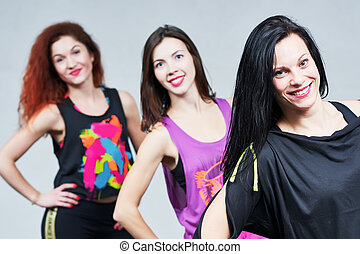 fitness woman. smiling instructors group portrait