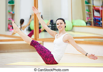 woman stretching in gym