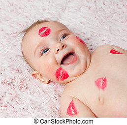 Newborn baby gir filled kisses - Newborn baby girl on the...
