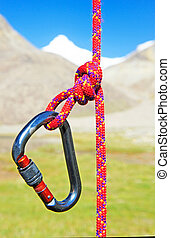 Climbing equipment - carabiner and rope