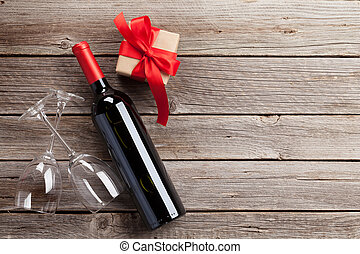 Valentines day greeting card. Red wine, gift box and glasses...