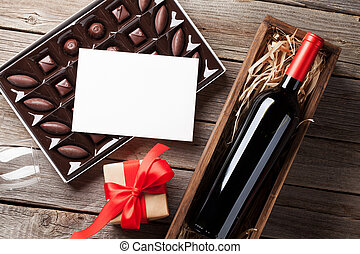 Valentines day greeting card. Red wine, gift box and...