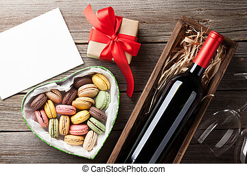 Valentines day greeting card. Red wine, macaroons gift box...