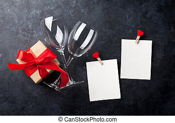 Valentines day greeting card. Red wine glasses, gift box and...
