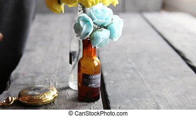 Happy Valentines Day tag and flowers in decorative bottles -...