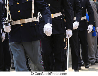many agents of italian police with weapons in military parade