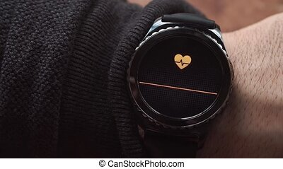 Lviv, Ukraine - January 2017: Smartwatch showing the heart...