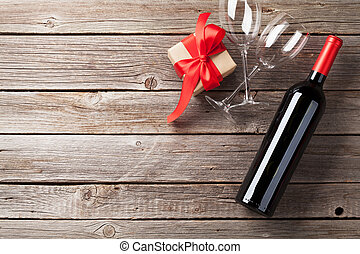 Red wine and gift box - Valentines day greeting card. Red...