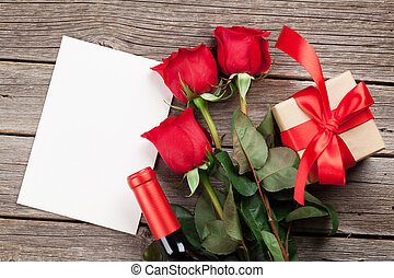 Valentines day greeting card. Red rose flowers, wine and...