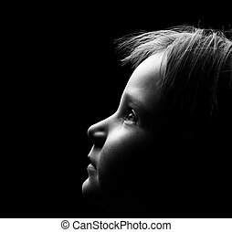 Young Child - Profile of a child's face with high contrast...