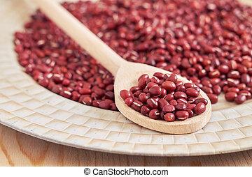 Adzuki red beans - Raw uncooked adzuki red beans in wooden...