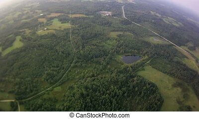 Aerial view of a winding river surrounded by green forest.