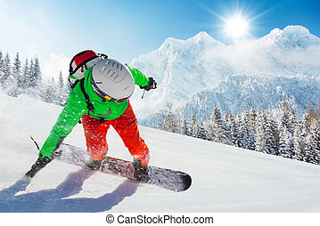 Snowboarder running downhill in beautiful Alpine landscape....