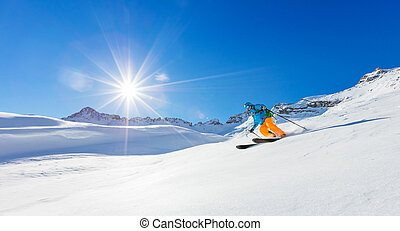 Freerider skier running downhill in beautiful Alpine...