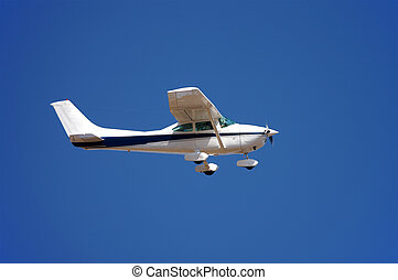 Small airplane against blue sky